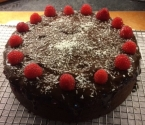 Dark (very dark) chocolate cake, ganache topping over a layer of homemade raspberry puree.